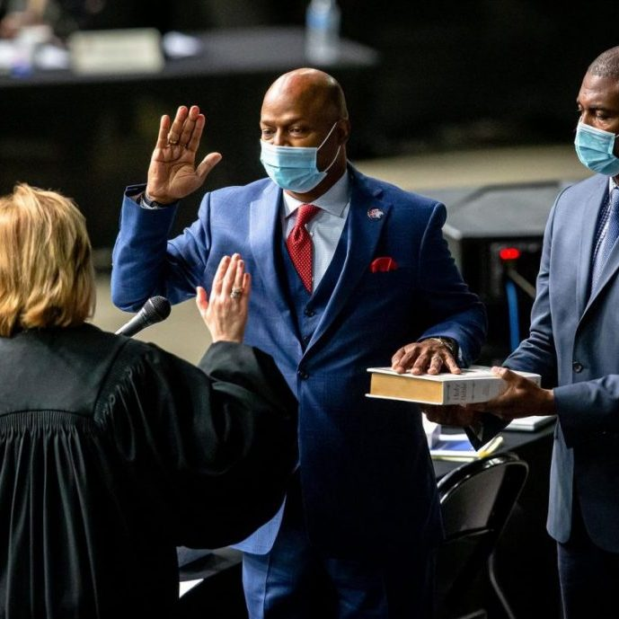 "Rep. Emanuel ""Chris"" Welch, D-Hillside, takes the Oath of Office to become the House speaker for the 102nd General Assembly for the Illinois House of Representatives on Wednesday at the Bank of Springfield Center. (Credit: Justin L. Fowler of The State Journal-Register)"