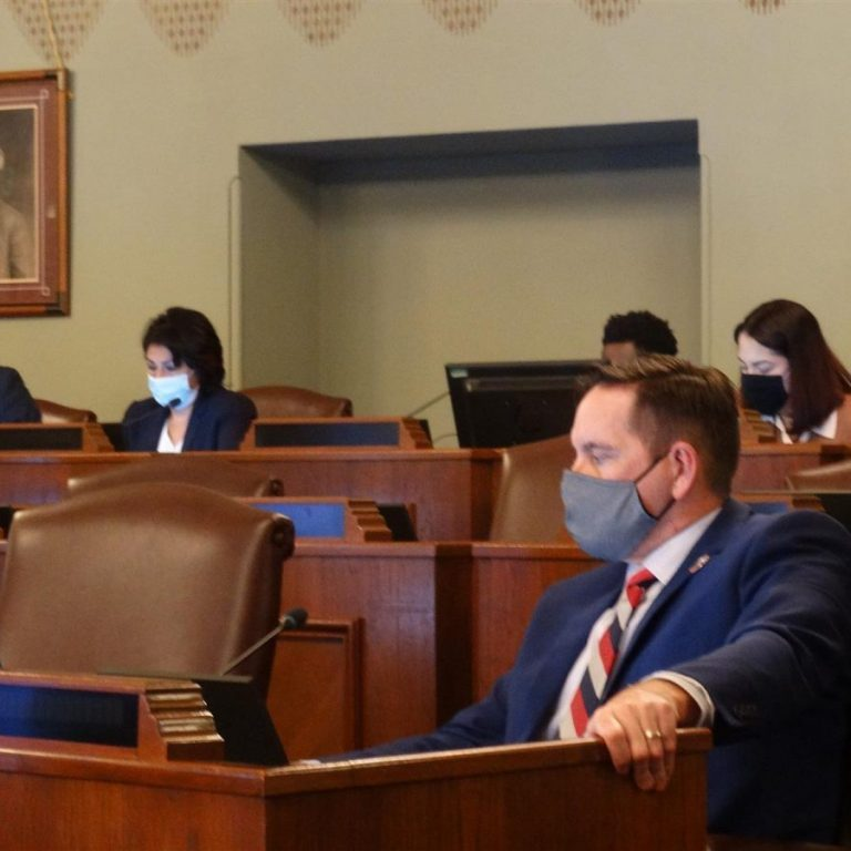Republican Rep. Tim Butler (front), of Springfield, and Democratic Rep. Lisa Hernandez (rear left), of Cicero, listen to testimony during a hearing of the House Redistricting Committee on Tuesday at the Capitol in Springfield. (Capitol News Illinois photo by Peter Hancock)